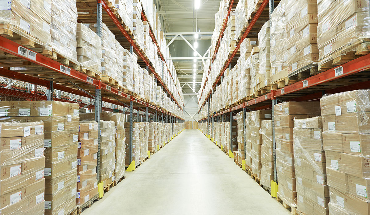 Image of warehouse with shelves of boxes.
